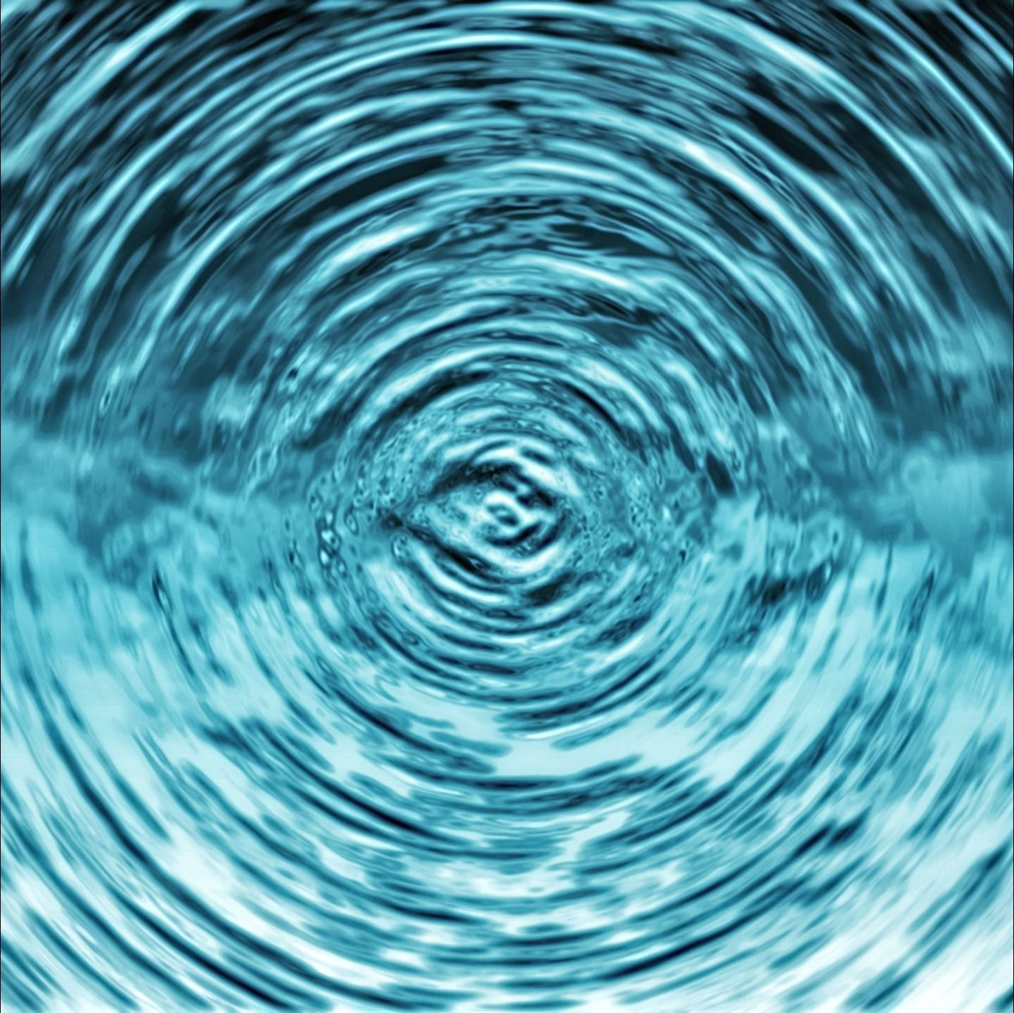 Ripples radiate outward from the center of a volume of water.